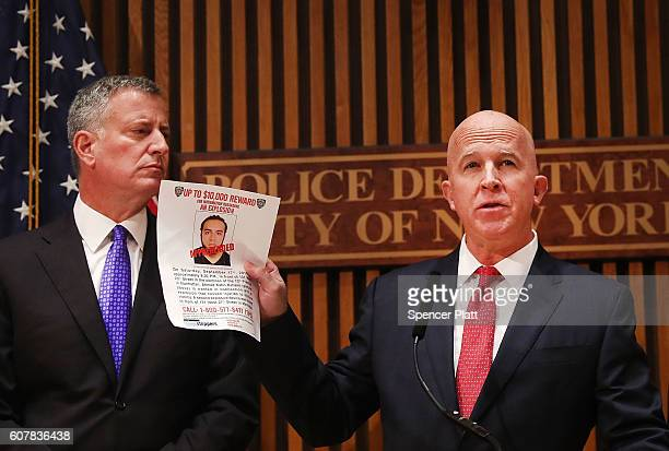 New York City police commissioner James O'Neill stands with Mayor Bill de Blasio as he holds up a picture of Ahmad Khan Rahami the man believed to be...