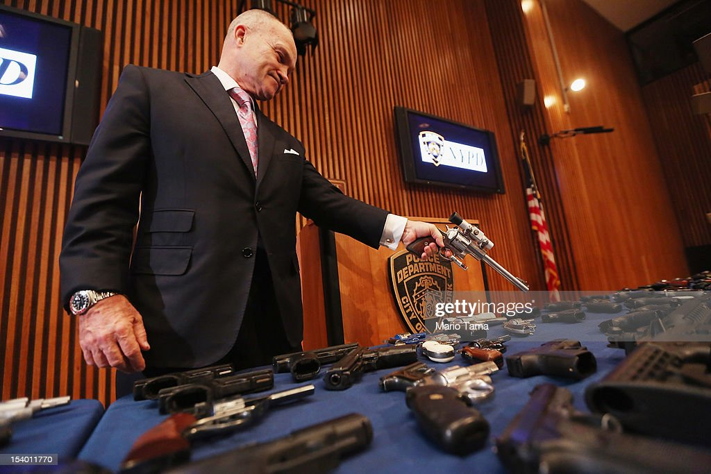 New York City Police Commissioner Ray Kelly displays a confiscated gun above a table of illegal firearms sold to undercover officers in a large weapons bust in East Harlem during a press conference on October 12, 2012 in New York City. NYPD detectives arrested 13 suspects for the illegal sale of 129 guns mostly purchased from gun dealers and pawn shops in South Carolina.