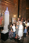 New York City Police Commissioner Raymond Kelly and children of families of honored NYPD officers light the Empire State Building on May 9 2011 in...