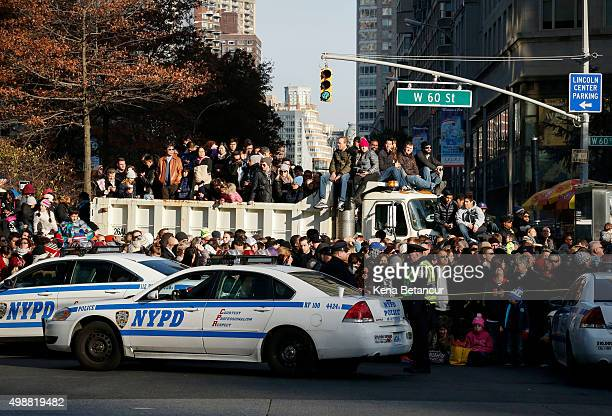 New York City Police department cars block a street as spectators await the annual Macy's Thanksgiving Day Parade on November 26 2015 in New York...