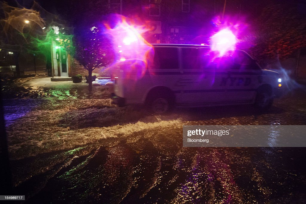 A New York City Police Department (NYPD) vehicle drives through flood water in the Red Hook neighborhood of Brooklyn in New York, U.S., on Monday, Oct. 29, 2012. Hurricane Sandy, the Atlantic's Ocean's biggest-ever tropical storm, barreled toward southern New Jersey after bringing a region with 60 million residents to a virtual standstill and upending the U.S. presidential race eight days before Election Day. Photograph: Victor J. Blue/Bloomberg via Getty Images