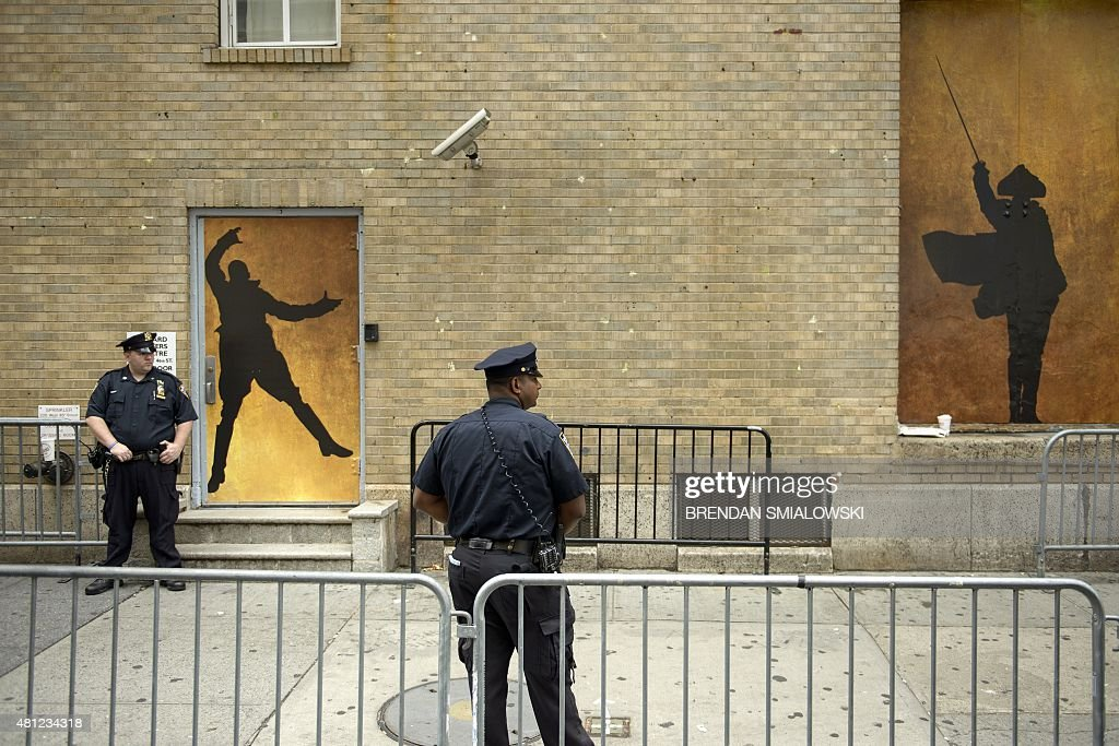 New York City Police guard the Richard Rodgers Theatre while US President Barack Obama attends a showing of 'Hamilton' with his daughter Sasha Obama...