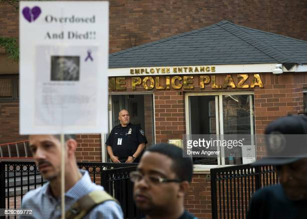 New York City Police officer looks on as activists rally during a protest to denounce the city's 'inadequate and wrongheaded response' to the...