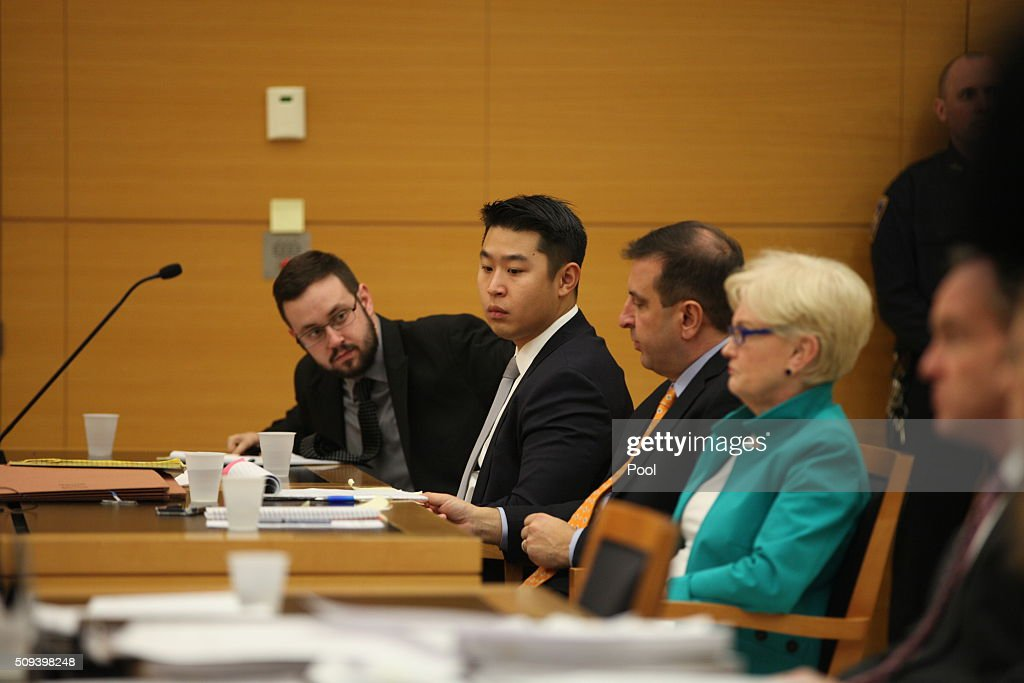 New York City police officer Peter Liang (2nd L) sits in court as testimony is read back for jurors during deliberations in his trial in Brooklyn Supreme Court February 10, 2016 in the Brooklyn borough of New York City. Liang is on trial for the shooting death of Akai Gurley in the stairwell of a housing project in November 2014.