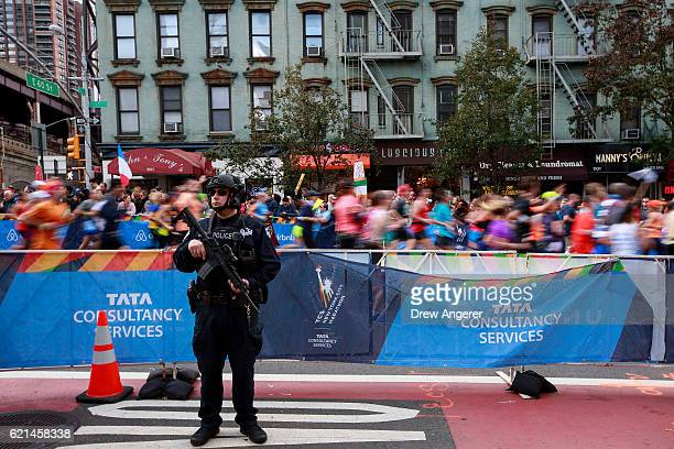 New York City Police officer stands guard as runners make their way north on First Avenue during the 2016 TCS New York City Marathon November 6 2016...