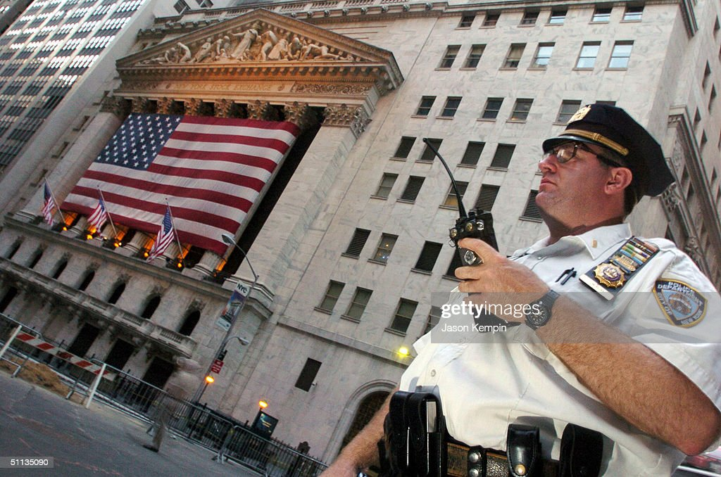 A New York City police officer stands guard near the New York Stock Exchange August 1, 2004 in New York City. The U.S. federal government raised the terror alert to orange in the New York City, Newark, New Jersey and Washington, DC areas amidst warnings of potential terrorist attacks against financial institutions.