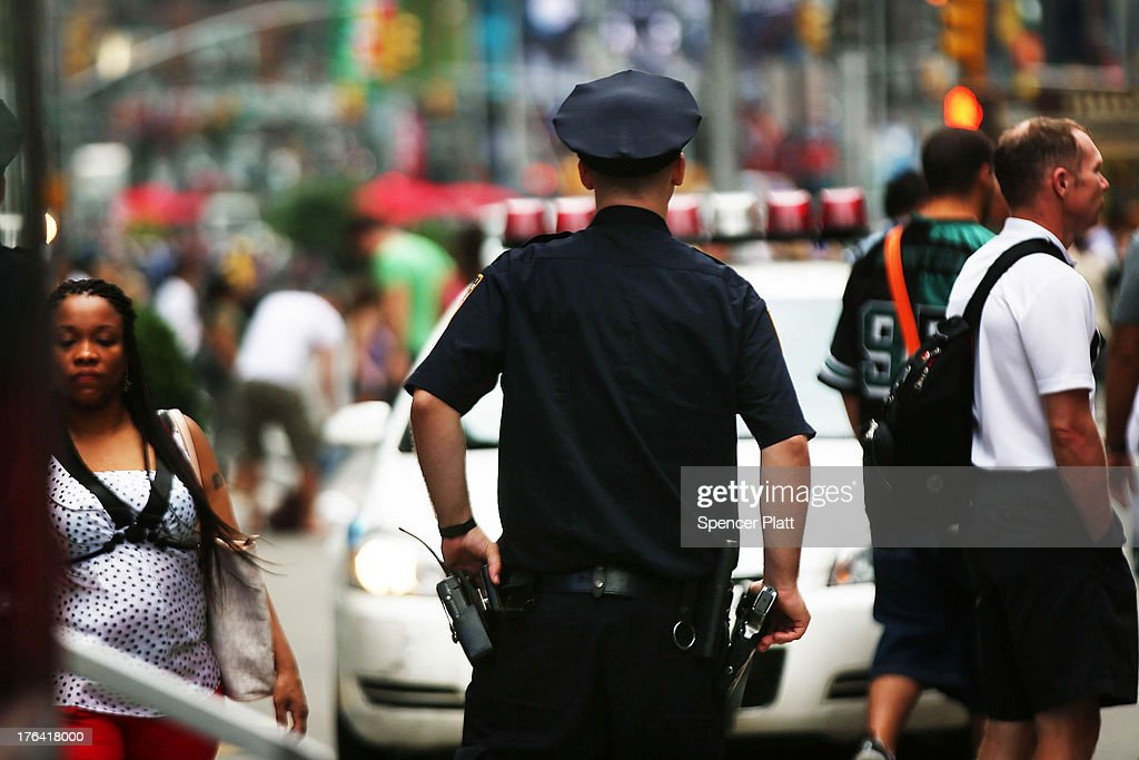 New York City police officer stands in Times Square on August 12 2013 in New York City The controversial policy employed by the New York Police...