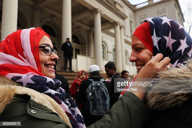 New York City Police Officers Aml Elsokary and Maritza Morales wear American Flag head scarfs at an event at City Hall for World Hijab Day on...
