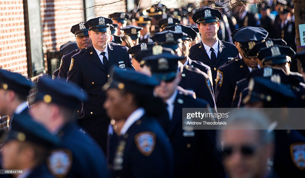 New York City police officers attend the wake of fellow NYPD officer Rafael Ramos at Christ Tabernacle Church on December 26 2014 in the Glendale...