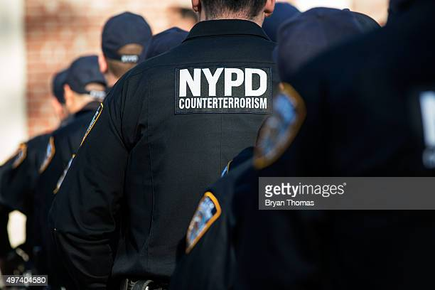 New York City Police officers await the announcement by New York City Mayor Bill de Blasio and New York Police Department Commissioner William...