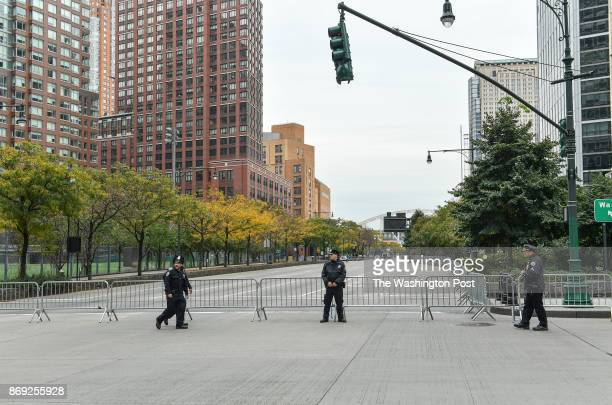 New York City Police officers guard West Highway near the scene where Sayfullo Saipov an Uzbek immigrant drove a rental truck down a bike path for...
