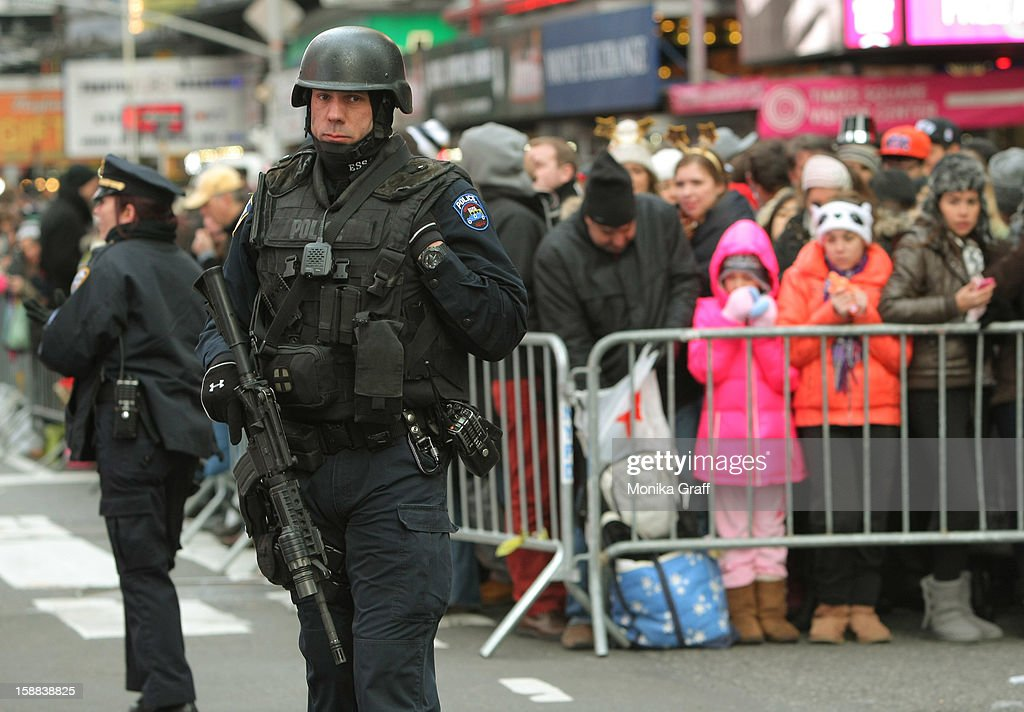 New York City police officers keep an eye on the crowds as hundreds of thousands of revelers gather in Times Square to celebrate New Year's Eve on December 31, 2012 in New York City. Approximately one million people are expected to ring in the new year in Times Square.