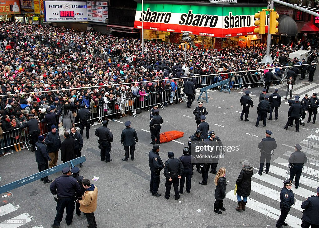 New York City police officers keep guard as revelers gather in Times Square to celebrate New Year's Eve on December 31, 2012 in New York City. Approximately one million people are expected to ring in the new year in Times Square.