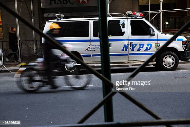 New York City police officers keep guard near One World Trade Center in lower Manhattan on November 24 2015 in New York City Following the terrorist...