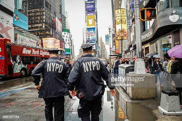 New York City Police officers patrol at Time Square after Iraqs prime minister alAbadi's explanation about the alleged bomb attacks on New York City...