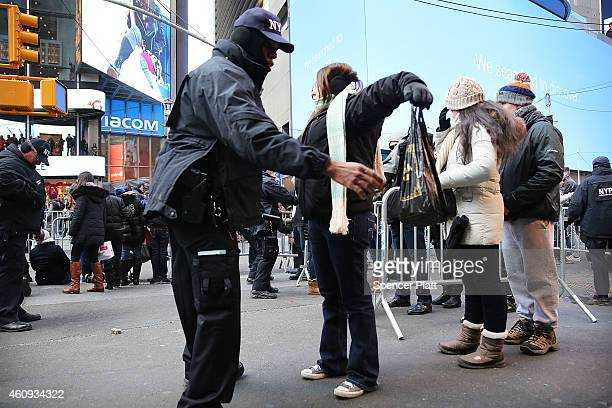 New York City police officers search revellers entering Times Square on December 31 2014 in New York City An estimated one million people from around...
