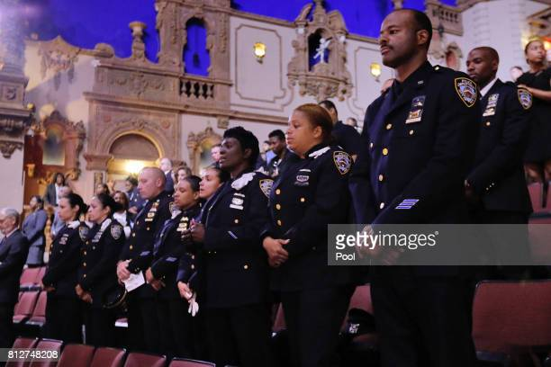 New York City Police officers stand during the funeral for New York City Police Officer Miosotis Familia at the World Changers Church July 11 2017 in...