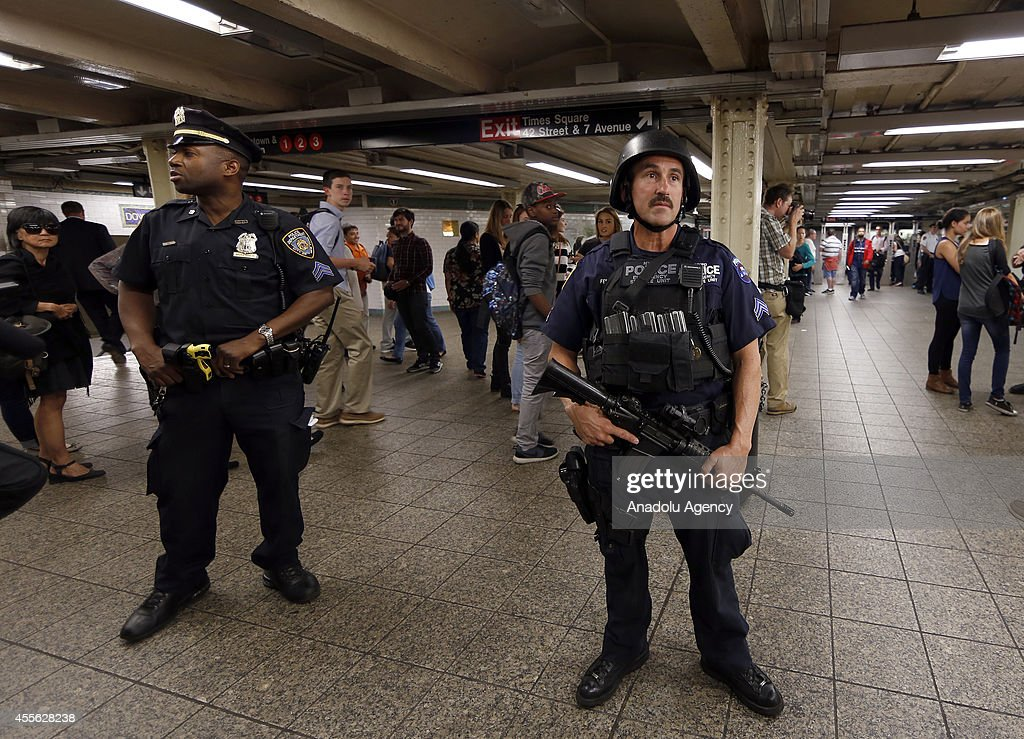 New York City Police officers stand guard in metro station in New York United States on 17 September 2014 Security measures tightened on critical...