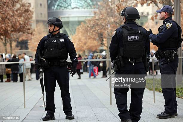 New York City police officers stand guard near One World Trade Center in lower Manhattan on November 24 2015 in New York City Following the terrorist...