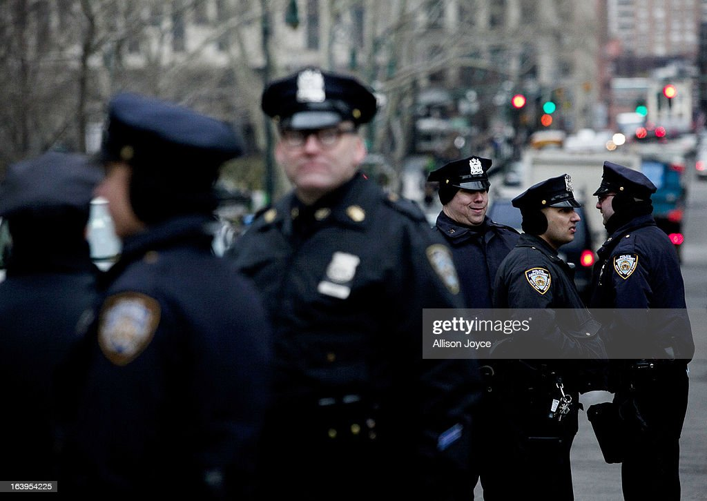 New York CIty Police officers watch over a demonstration against the city's 'stop and frisk' searches in lower Manhattan near Federal Court March 18, 2013 in New York City. Hearings in a federal lawsuit filed by four black men against the city police department's 'stop and frisk' searches starts today in Manhattan Federal Court.