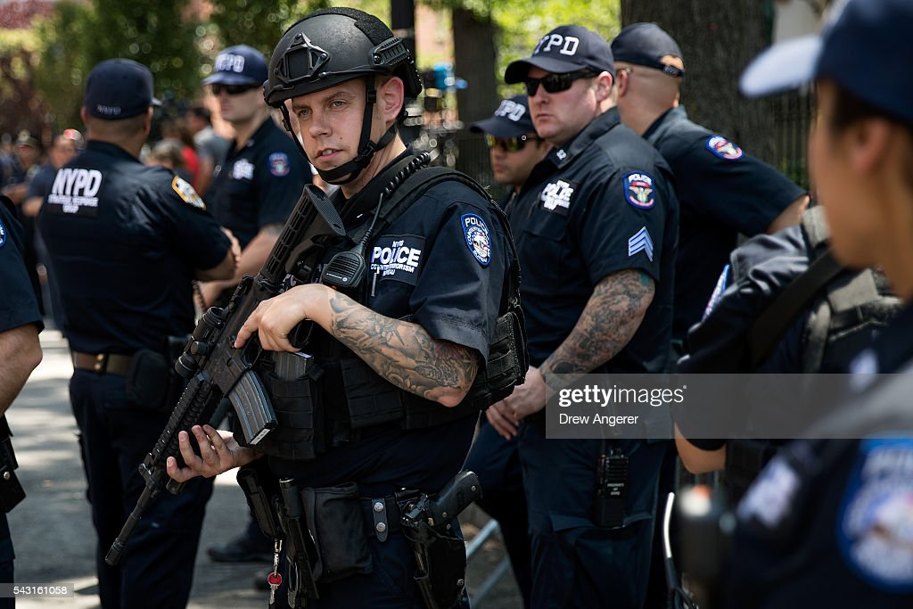 New York City Police officers watch the crowd during the New York City Pride March, June 26, 2016 in New York City. This year was the 46th Pride march in New York City.