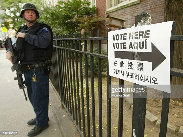 New York City Police tactical team member stands guard outside a polling place at PS 6 November 2 2004 on the Upper East Side of New York City Polls...
