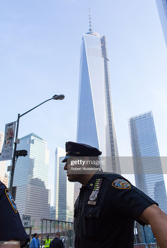 New York City policemen stand near the World Trade Center September 11, 2013 in the Manhattan borough of New York.