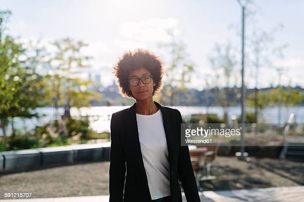 USA, New York City, portrait of businesswoman at backlight