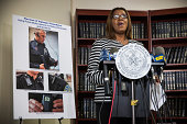 New York City Public Advocate Letitia James displays a video camera that police officers could wear on patrol during a press conference on August 21...
