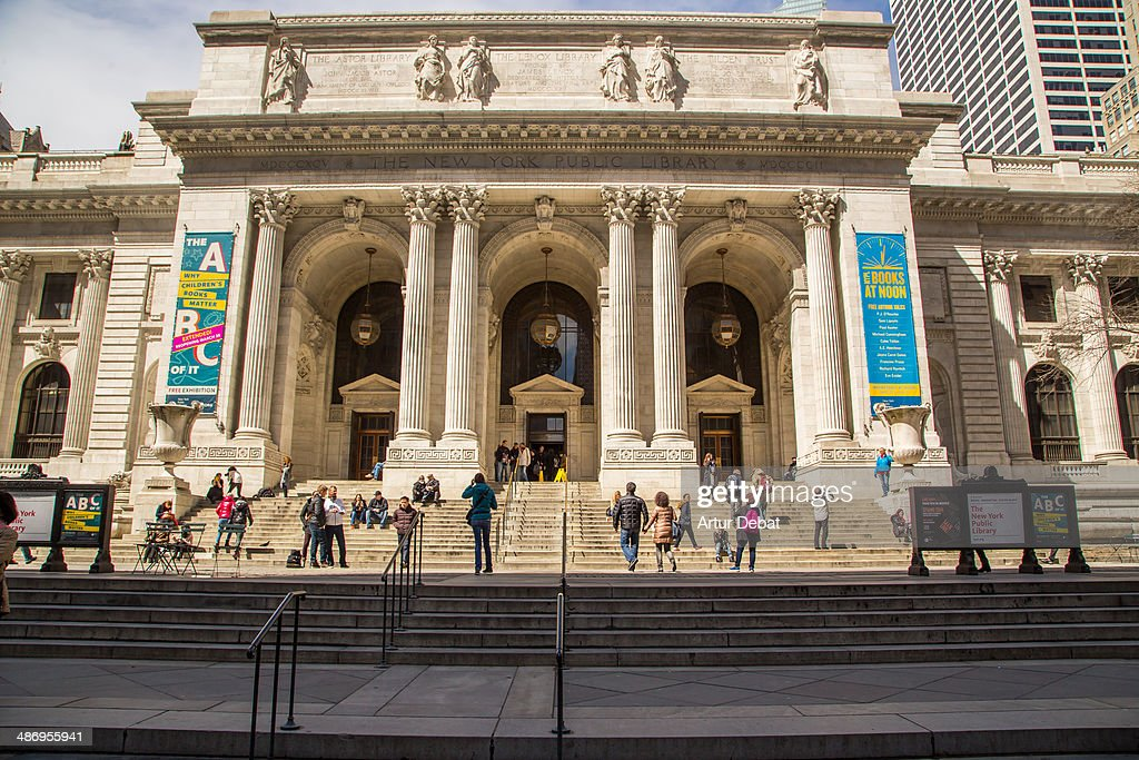 New York City Public Library outside with people and sunny day