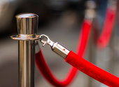 USA, New York City, Red rope and stanchion