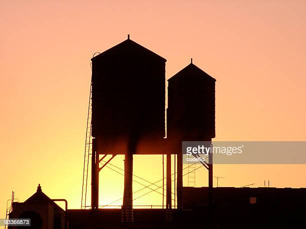 New York City rooftop water tanks at sunset, copy space