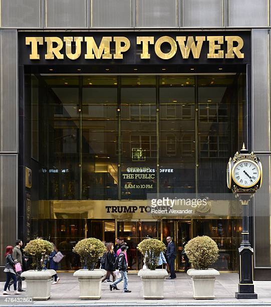 New York City shoppers and visitors walk past the entrance to Trump Tower on Fifth Avenue a mixed use skyscraper owned by Donald Trump
