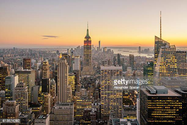 New York City skyline with illuminated skyscrapers seen from above during sunrise, New York State, USA