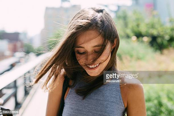 USA, New York City, smiling brunette young woman outdoors