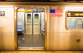 New York City subway open train with USA flag