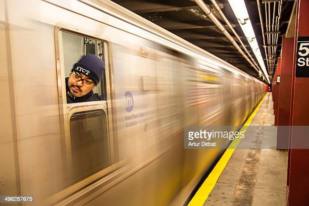 New York City subway worker with mustache and head out through the window train in movement New York USA