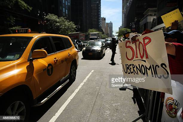 New York City taxi drivers hold a rally in front of Governor Andrew Cuomo's office to protest against recent inroads made by the Uber car service on...
