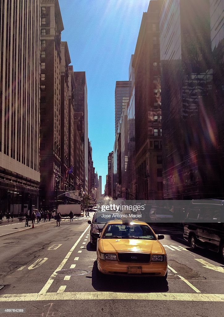 A New York City Taxi stopped at Madison Ave, with E 47th St. Picture taking with an iPhone 4s. Facing South.