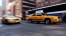 New York City taxis speed down Broadway October 10 2001 in New York Taxi drivers have seen their incomes drop significantly since the terrorist...