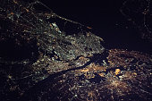 New York City - the Bronx, Manhattan, Queens, Brooklyn and Staten Island, and part of the state of New Jersey night space view (elements of image furnished by NASA)