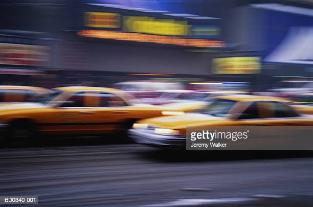 USA, New York City, Times Square, taxis (blurred motion)