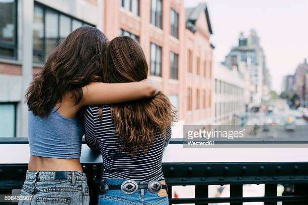 USA, New York City, two friends enjoying the view of the city