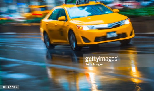 USA, New York City, Yellow cab in blurred motion : Stock Photo