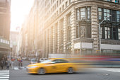 New York City yellow taxi cab speeding down Broadway in Manhattan NYC