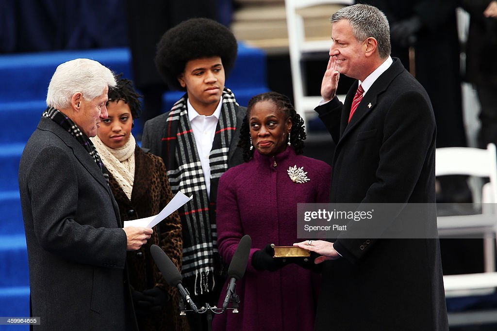 New York City's 109th Mayor, <a gi-track='captionPersonalityLinkClicked' href=/galleries/search?phrase=Bill+de+Blasio&family=editorial&specificpeople=6224514 ng-click='$event.stopPropagation()'>Bill de Blasio</a>(right), is sworn in by former President <a gi-track='captionPersonalityLinkClicked' href=/galleries/search?phrase=Bill+Clinton&family=editorial&specificpeople=67203 ng-click='$event.stopPropagation()'>Bill Clinton</a>(left) as his family watches, <a gi-track='captionPersonalityLinkClicked' href=/galleries/search?phrase=Chiara+de+Blasio&family=editorial&specificpeople=11364182 ng-click='$event.stopPropagation()'>Chiara de Blasio</a> (2nd from left) <a gi-track='captionPersonalityLinkClicked' href=/galleries/search?phrase=Dante+de+Blasio&family=editorial&specificpeople=11364181 ng-click='$event.stopPropagation()'>Dante de Blasio</a> (center) and wife <a gi-track='captionPersonalityLinkClicked' href=/galleries/search?phrase=Chirlane+McCray&family=editorial&specificpeople=8014891 ng-click='$event.stopPropagation()'>Chirlane McCray</a> (2nd from right) at City Hall on January 1, 2014 in New York City. Mayor de Blasio was sworn in using a Bible once owned by President Franklin Delano Roosevelt. Following the 12 years of the Michael Bloomberg administration, Mayor de Blasio won on a liberal platform that emphasized the growing gulf between the rich and poor in New York City.