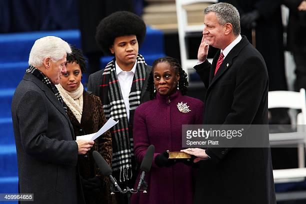 New York City's 109th Mayor Bill de Blasio is sworn in by former President Bill Clinton as his family watches Chiara de Blasio Dante de Blasio and...