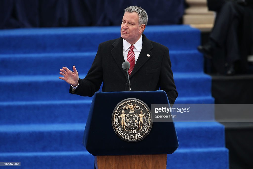 New York City's 109th Mayor, <a gi-track='captionPersonalityLinkClicked' href=/galleries/search?phrase=Bill+de+Blasio&family=editorial&specificpeople=6224514 ng-click='$event.stopPropagation()'>Bill de Blasio</a>, speaks after being sworn-in as mayor at City Hall on January 1, 2014 in New York City. Mayor de Blasio was sworn in using a Bible once owned by President Franklin Delano Roosevelt. Following the 12 years of the Michael Bloomberg administration, Mayor de Blasio won on a liberal platform that emphasized the growing gulf between the rich and poor in New York City.