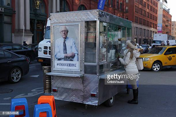 New York coffee cart displaying a photo endorsing Bernie Sanders