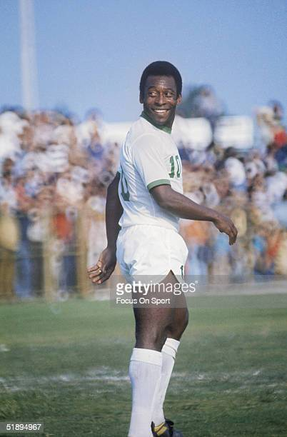New York Cosmos' Pele walks across the field